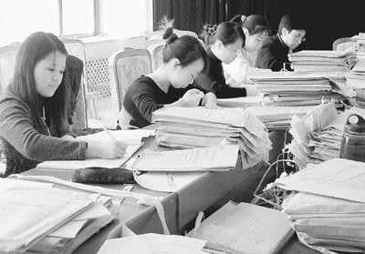 自学考试所有科目纸质阅卷(上图)均被网上阅卷(下图)所取代